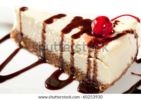 Cheesecake with Chocolate Sauce and Cherries