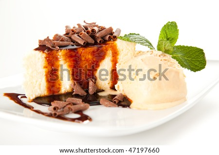cheesecake  with ice cream, chocolate shavings and mint