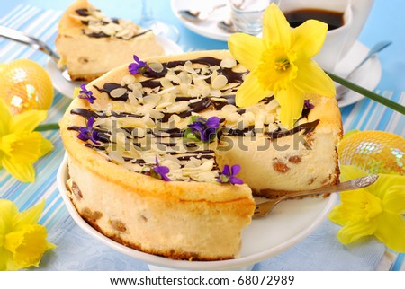 cheesecake with raisins and  almonds poured chocolate for easter