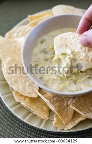 Cheesy Artichoke Dip Served with Tortilla Chips