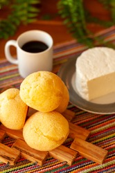 Cheesy bread with cup of coffee and white cheese.