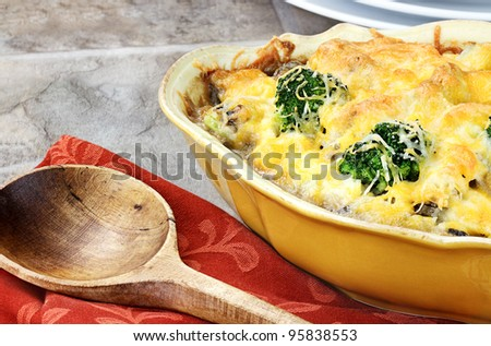 Cheesy broccoli casserole made with cheddar cheese, broccoli, portabella mushrooms and rice.