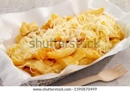cheesy chips in take away tray Stock photo ©