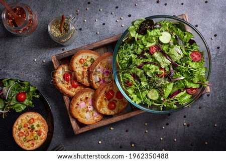 Cheesy Garlic bread with everyday salad.  Stock photo ©