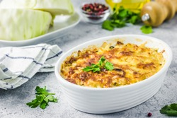 Cheesy suffed cabbage and mushroom casserole. Selective focus, space for text.