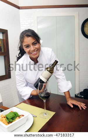 chef at restaurant showing the wine for dinner