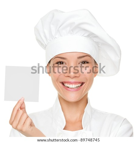 Chef, baker or cook woman showing blank sign card wearing chefs uniform and hat. Blank card for menu, gift card, offer etc Beautiful multicultural Asian / Caucasian female isolated on white background