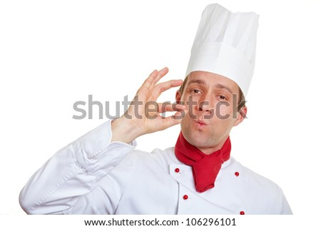 Chef cook making okay gesture with his hands after tasteful meal
