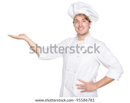 Chef, Cook or baker showing isolated. Male chef presenting your product. Young Caucasian man isolated on white background in chefs uniform.