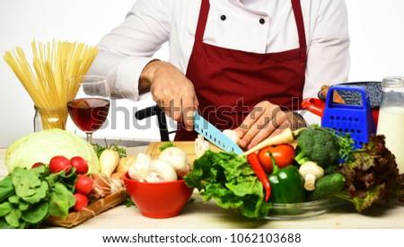 Chef cooking food cutting mushroom. Meal preparation concept. Hands hold knife preparing vegetables #1062103688