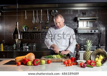 chef cooking food kitchen restaurant cutting cook hands hotel man male knife preparation fresh preparing concept #686189689