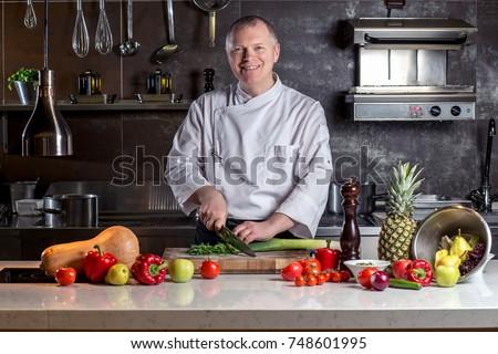 chef cooking food kitchen restaurant cutting cook hands hotel man male knife preparation fresh preparing concept #748601995