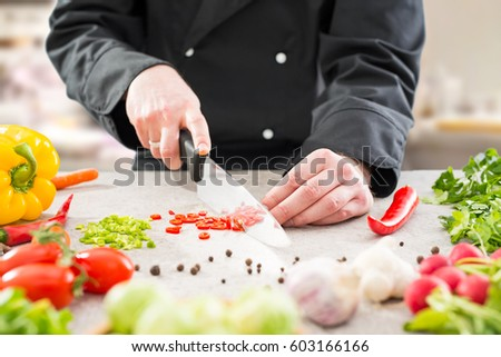 chef cooking food kitchen restaurant cutting prepare cook hands healthy hotel man male knife preparation fresh preparing young natural culinary domestic desktop dietary red concept - stock image  #603166166
