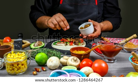 chef cooking mexican taco. Cook preparing delicious mexican taco at kitchen. Tasty mexican cuisine. concept cooking recipe.