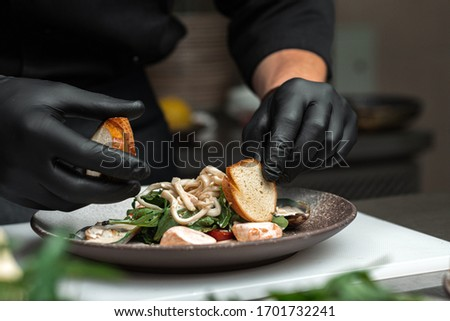 chef cooks salad and seafood sauce in the kitchen Stock photo ©