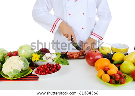 Chef cuts the vegetables. Isolated on white