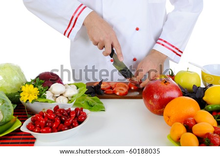 Chef cuts the vegetables. Isolated on white background