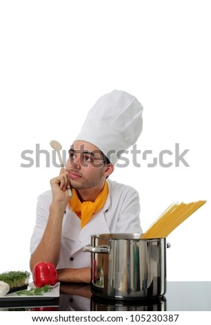 Chef daydreaming while making spaghetti with fresh ingredients and the pasta ready to boil