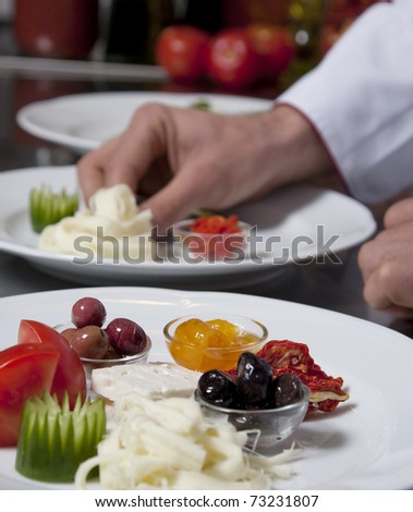 Chef decorating a plate in the kitchen