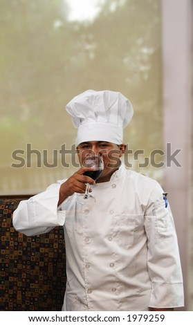 chef drinking wine looking from front