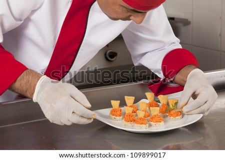 chef garnishing canapes