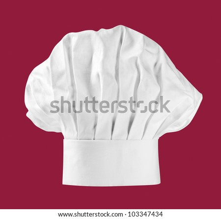 Chef hat or toque on dark red