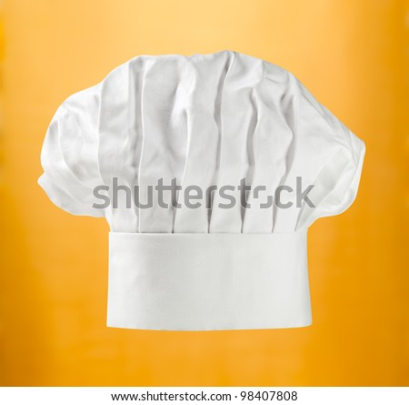 Chef hat or toque on gold (with clipping path)