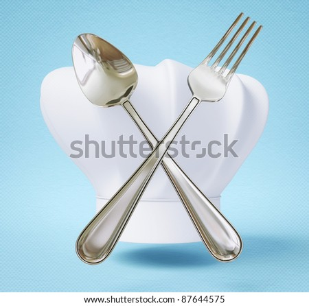 chef hat with spoon and fork isolated on a blue