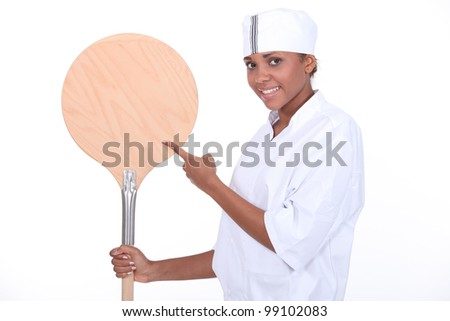 chef holding a pizza peel - stock photo