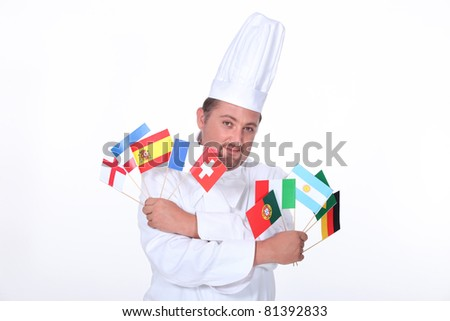 Chef holding flags - stock photo