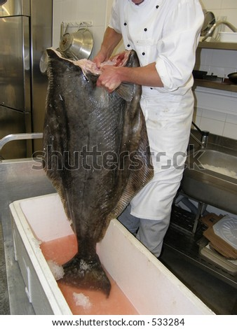 Chef holding the paltus before prepare for cutting