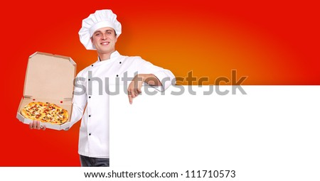 Chef holding the pizza in a box and the blank board on orange background