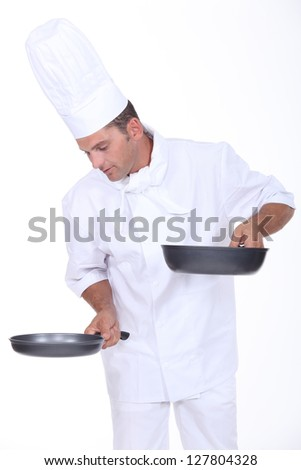 Chef holding two saucepans