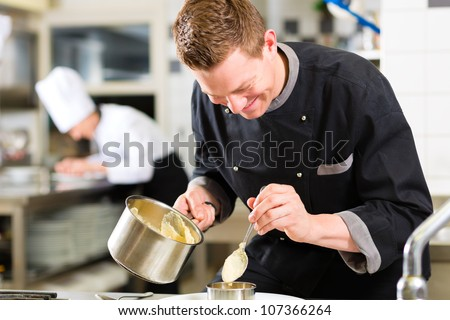 Chef in hotel or restaurant kitchen cooking, he is working on the sauce for the food as saucier
