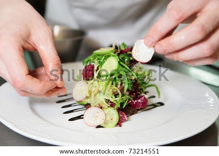 Chef is decorating appetizer
