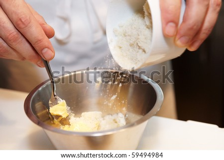 Chef is preparing dish ingredient of cheese and butter