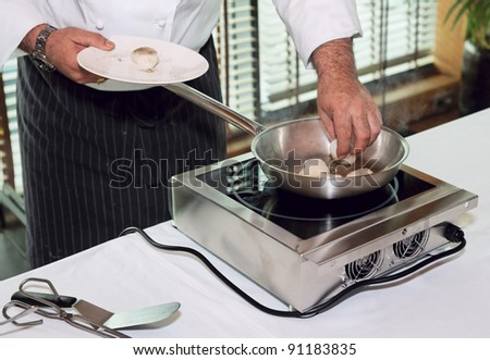 Chef is preparing mussels on induction stove