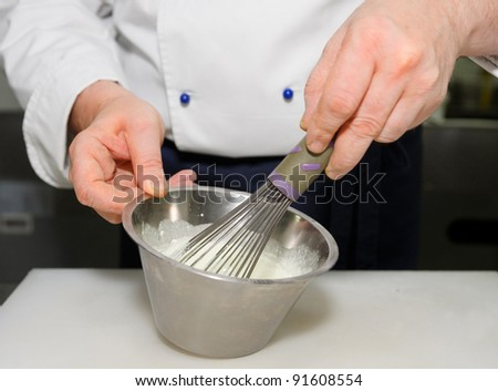Chef is preparing sauce on restaurant kitchen