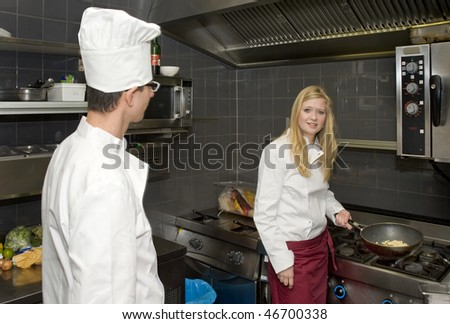 Chef looking at his assistant in a professional kitchen