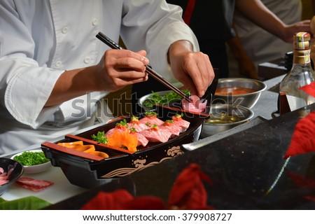 Chef making kobe sushi on boat, japanese wagyu beef sushi