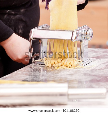 chef making pasta - stock photo