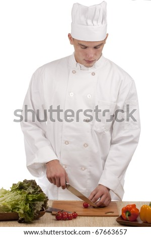 Chef Man cut vegetables on kitchen blackboard.