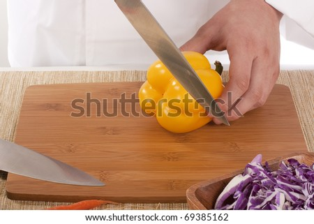 Chef Man cut vegetables on kitchen blackboard.