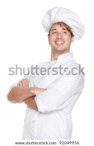 Chef man. Proud portrait of smiling happy cook, chef or baker wearing chefs hat. Cross-armed young Caucasian male model isolated on white background.
