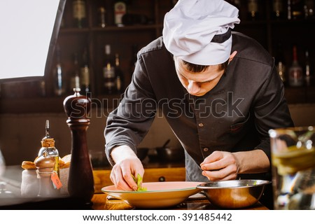 chef prepares broccoli green soup puree with celery on the wooden background. vegetarian diet, cooking,