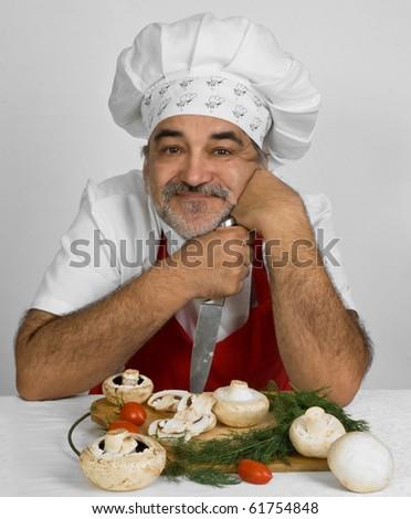 chef prepares mushrooms