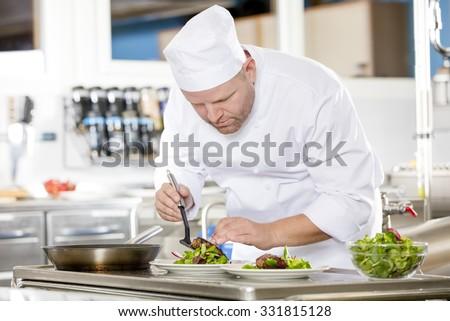 Chef prepares steak dish at gourmet restaurant