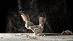 chef prepares the dough with flour to make pasta. Pizza dough. Cooking bread. Kneading the Dough. the concept of nature, Italy, food, diet and bio.