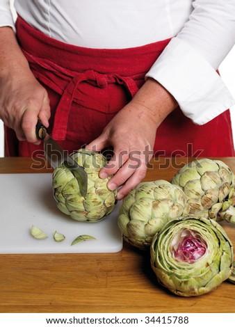 Chef preparing artichoke