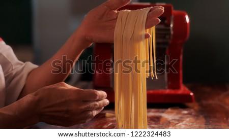 Chef Preparing Homemade Artisan Fettuccine Pasta